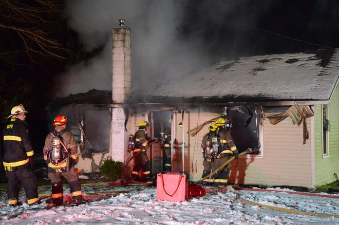 Fire destroyed a small, vacant house in Bedford Township on Thursday.  (Trace Christenson/The Enquirer)