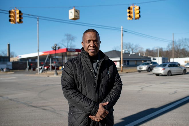Pastor Chris McCoy from New Level Sports Ministries stands for a portrait on Thursday, Jan. 21, 2021 in the Washington Heights neighborhood of Battle Creek, Mich. The City Commission planned to sell a plot of land in the neighborhood to a housing development company, but after hearing concerns about the proposed project from McCoy and other community members, the city is putting a pause on the sale.