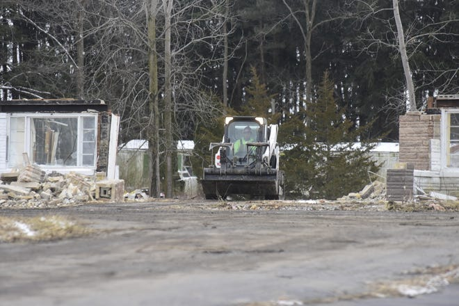 A demolition worker drives a skid loader through the front door of what was once Al Smith's Place in Bucyrus on Wednesday afternoon. The building is being demolished to make way for an Aldi grocery store.
