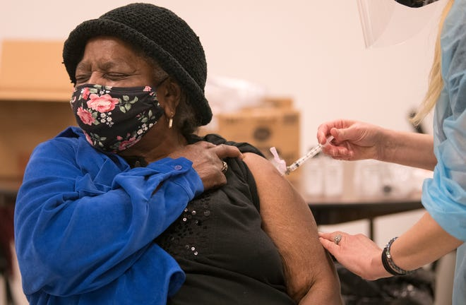 Jennie McRae, 73 of Camden, receives the Moderna COVID-19 vaccine from Dr. Stephanie Santoro of Project HOPE at the First Nazarene Baptist Church in Camden on Thursday, January 21, 2021. The vaccinations for Camden seniors were made possible via a partnership between Project H.O.P.E., the Board of County Commissioners, Cooper's Ferry Partnership, and the City of Camden.
