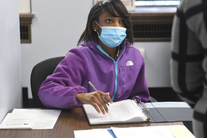 Dasaray Jones fills out paperwork and receives instruction during a training session at Addus Detroit Home Care offices in the Fisher Building on Thursday, Jan. 21, 2021 for caregivers who are joining the workforce.