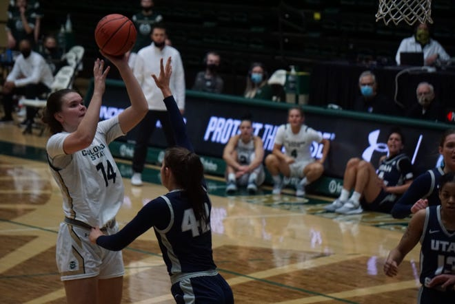 Colorado State's Cali Clark puts up a shot over Utah State defender Taylor Franson during Wednesday night's game at Moby Arena. The Rams won 90-59.