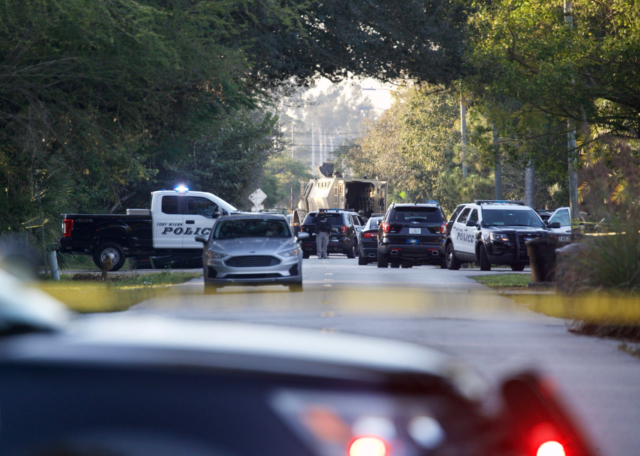 Fort Myers police shut down area near downtown for man barricaded inside home; shots fired