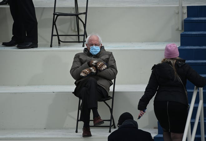 U.S. Sen. Bernie Sanders, D-Vermont, sits in the bleachers on Capitol Hill before Joe Biden is sworn in as the 46th U.S. president on Wednesday in Washington, D.C.