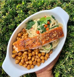"""""""Food can still be comforting, but it can also be healthy and taste great."""" This salmon filet atop a bed of chick peas and noodles is all three. Oct. 11, 2020."""