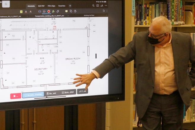 Berne Union Local Schools Superintendent Jon Parker points to plans for a new bus garage for the school during a special school board meeting Wednesday, Jan. 20. The meeting allowed members of the Schorr Architects, Inc. to show the school board plans for two additional buildings, included with the new kindergarten through 12th grade building being planned.