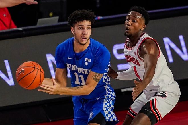 Kentucky guard Dontaie Allen controls the ball against Georgia guard Tye Fagan during the teams' game earlier in the season. Allen leads the Wildcats in 3-point shooting, hitting 23 of 50 from distance this season.