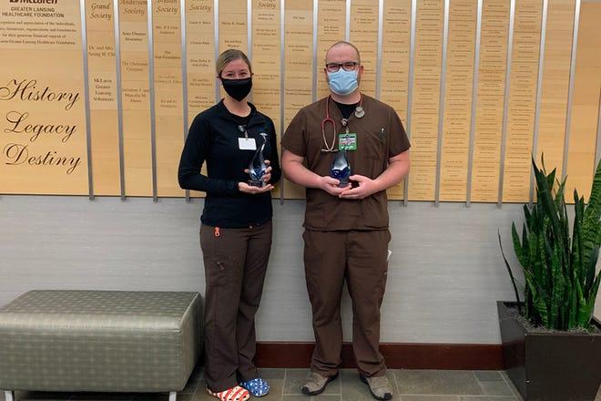 Megan Decker and Chris Medina, respiratory therapists at McLaren Greater Lansing, won the annual Janet M. Wendorf Outstanding Caregiver Award in December.