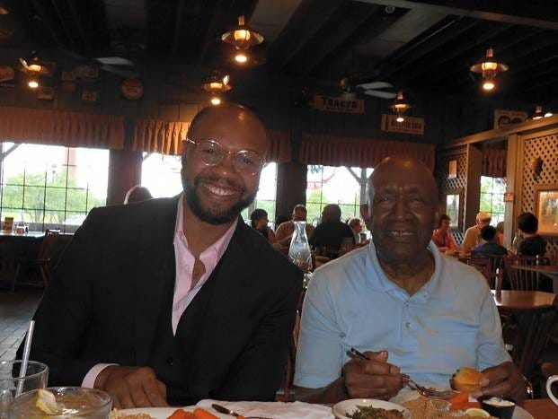 Johnnie Jackson, left, with his grandfather, Robert Jackson, Jr. The eldest Jackson died in April from COVID-19 at the age of 88.