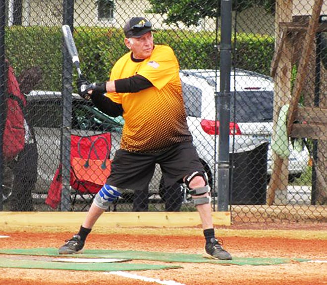 Jerry Engel strides into a pitched ball against Joey's Pizza