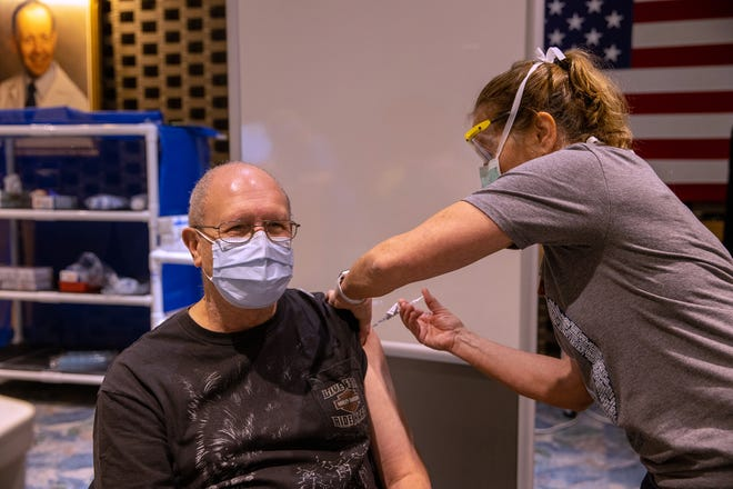Veteran Gene Wisch gets a COVID-19 vaccination on Saturday, Jan. 16, 2021, at the walk-in clinic at the Milwaukee VA.