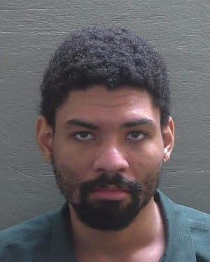 Pierre Woods was captured in Escambia County, Florida, and served a warrant on a charge of murder in connection with the November death of Joshua Thompson.