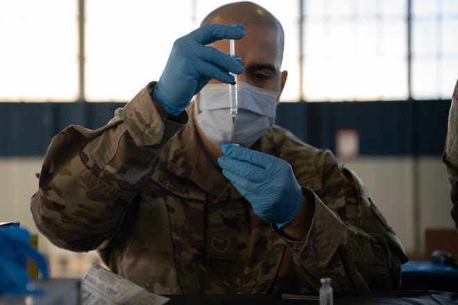 Staff Sgt. Jason Medina, 42nd Medical Group immunizations noncommissioned officer in charge, prepares the COVID-19 vaccine for administration Jan. 16, 2020, at the off-site clinic in the Honor Guard hangar on Maxwell Air Force Base, Alabama. Vaccines are currently voluntary and will be administered via appointment only, adhering to the prioritization schema developed by the Centers for Disease Control and Prevention and the Department of Defense.