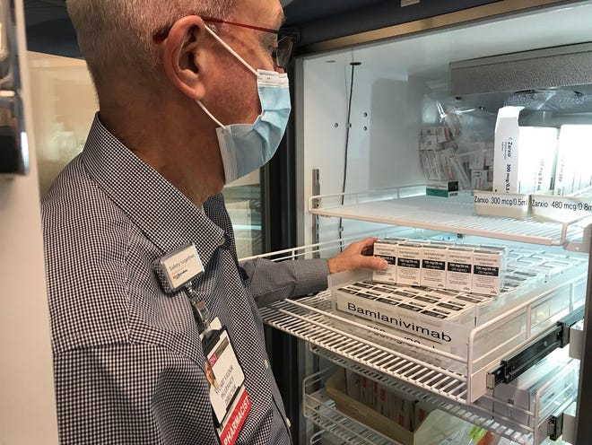 A pharmacist checks on the supply of Eli Lilly's monoclonal antibody treatment for newly diagnosed COVID-19 patients at Robert Wood Johnson University Hospital in Somerset, NJ.