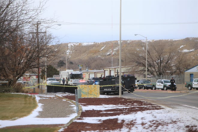 Multiple law enforcement agencies were involved in a standoff and fatal shooting on Dec. 14 in the roadway of West Murray Drive in Farmington. William Hernadez, 46, was shot and killed after pointing a handgun at the head of a man while inside an SUV.