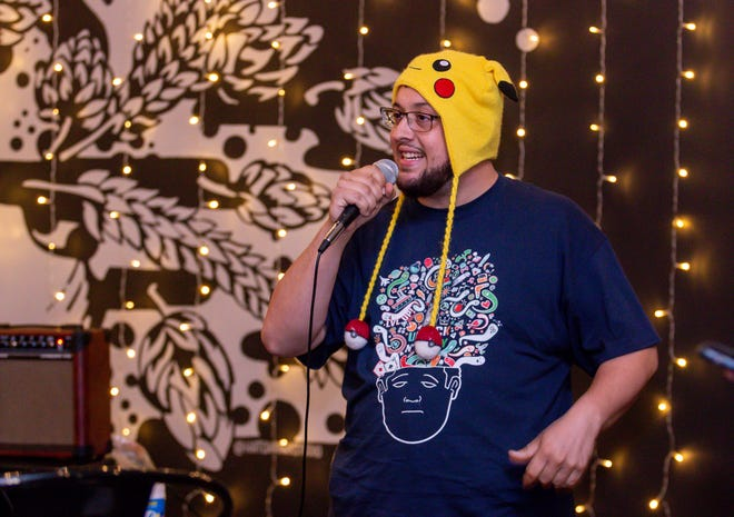 Comedian Andrew Ferrara, shown entertaining the crowd at Emerald Republic Brewing Co. on Jan. 20, organized this year's Pensacola Pre-Pride Comedy Festival.