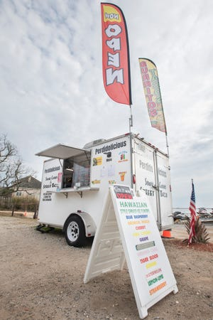 The Perdidolicious food truck is parked on Gulf Beach Highway in Perdido Key in January. Milton is exploring the idea of amending its food truck ordinance to allow gatherings of trucks or outdoor kitchens.