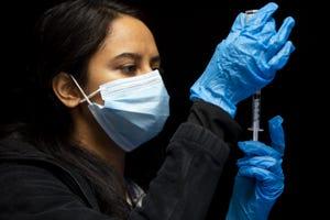 A public health nurse prepares a COVID-19 vaccination at Hayden High School in Winkelman, Ariz. on Jan. 21, 2021.