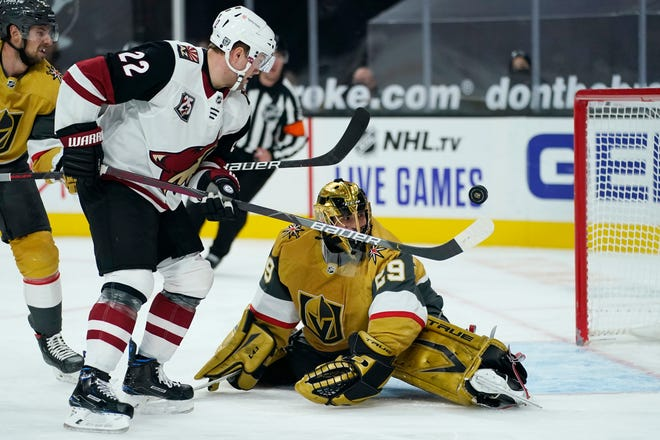 Vegas Golden Knights goaltender Marc-Andre Fleury (29) blocks a shot by Arizona Coyotes left wing Johan Larsson (22) during the first period of an NHL hockey game Wednesday, Jan. 20, 2021, in Las Vegas. (AP Photo/John Locher)
