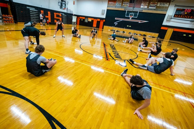 The Marine City Mariners stretch during practice Wednesday, Jan. 20, 2021, at Marine City High School.