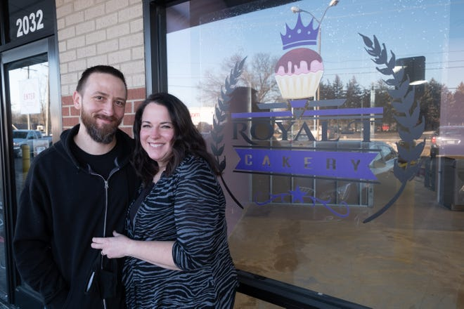 Al and Bev Taylor pose for a portrait Thursday, Jan. 21, 2021, outside the future home of Royal-T Cakery in Port Huron. The couple are moving their business from their home to a storefront on Holland Avenue.
