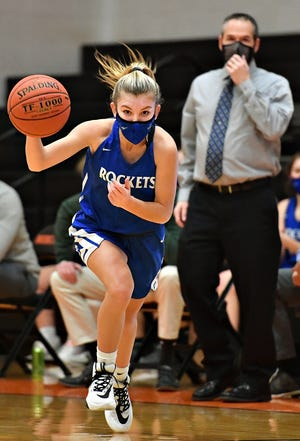 Spring Grove's Addyson Wagman moves the ball down the court during girls' basketball action against Northeastern at Northeastern Senior High School in Manchester, Wednesday, Jan. 20, 2021. Spring Grove would win the game 64-54. Dawn J. Sagert photo