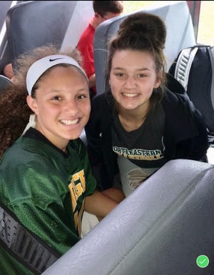 Taylor Farris (left) and Jenna McFarland (right) on the team bus.
