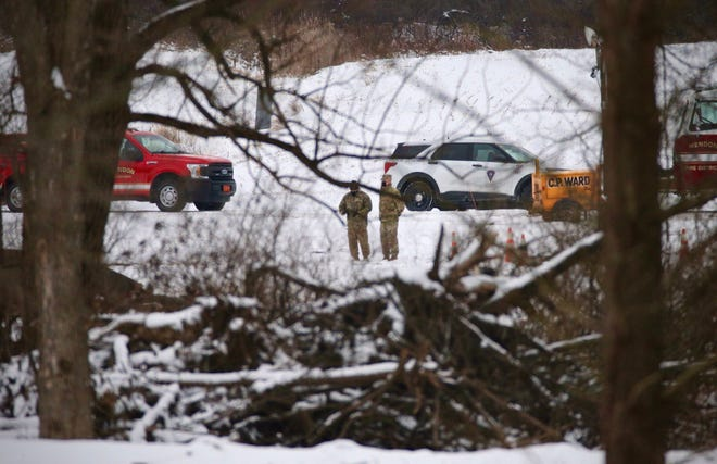 Investigators are on the scene of a fatal military helicopter crash near West Bloomfield Road in Mendon on Thursday, Jan, 21, 2021.