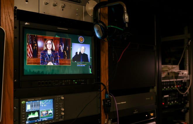 Gov. Kate Brown's State of the State address plays on a display in the media control room at the Oregon State Capitol on Thursday. Brown's address was prerecorded and released on YouTube and the Oregon Legislative Information System.