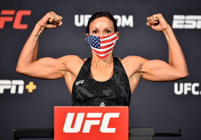 June 19, 2020; Las Vegas, NV, USA; Marion Reneau poses on the scale during weigh-ins for UFC Fight Night at the UFC APEX.  Mandatory Credit:  Chris Unger/Zuffa LLC via USA TODAY Sports