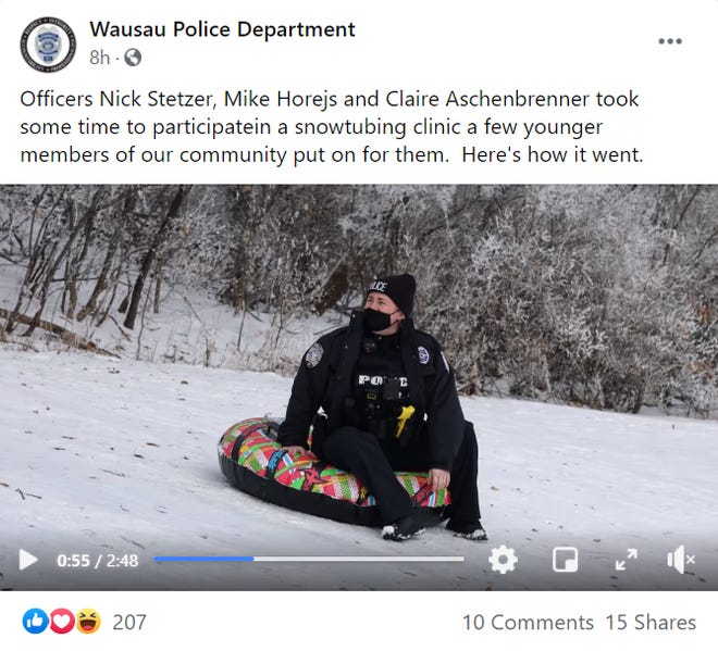 A screenshot of a video posted to the Wausau Police Department's Facebook page.  Three officers joined local kids as they went sledding.