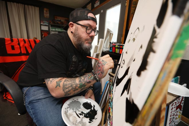 Zanesville artist J.D. Dunlap works on a painting of Marilyn Monroe. Balancing his art with a full time truck driving job, Dunlap concentrates on pop culture figures in his work.
