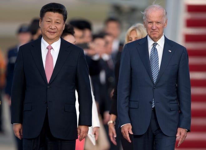 Chinese President Xi Jinping and President Joe Biden on Sept. 24, 2015, at Andrews Air Force Base, Maryland.