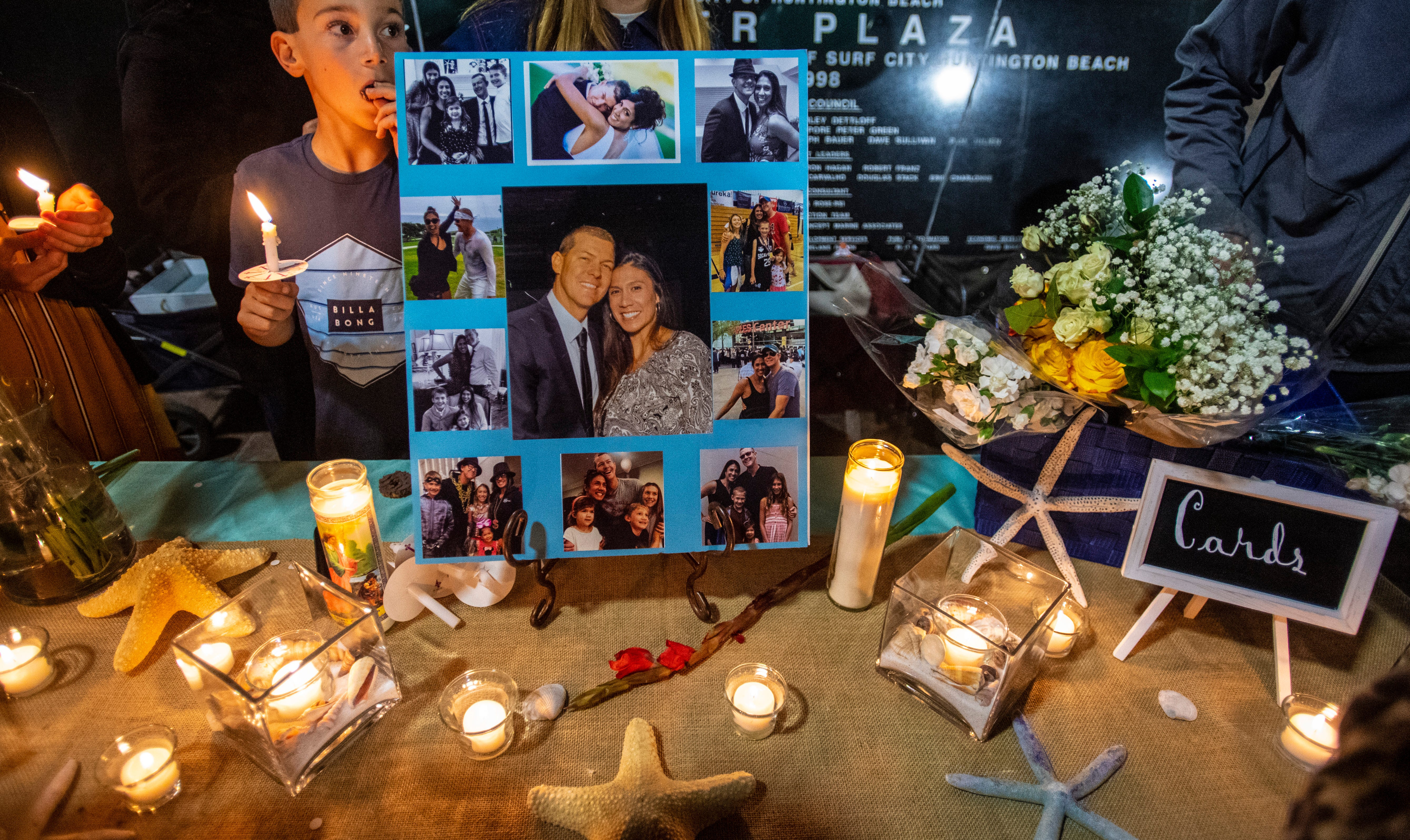Photos of Christina Mauser are displayed for a vigil held the evening of Jan. 26 following a helicopter crash that killed her and eight others.