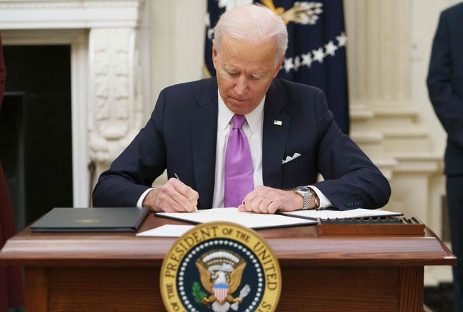 An executive order requiring masks on public transportation such as airlines, trains and buses was one of several signed by President Biden on his first full day in office.