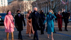 President Joe Biden and first lady Jill Biden walk along Pennsylvania Avenue in front of the White House during Inaugural celebrations, on January 20, 2021 with family members after US President Biden was sworn in as the 46th President of the United States.