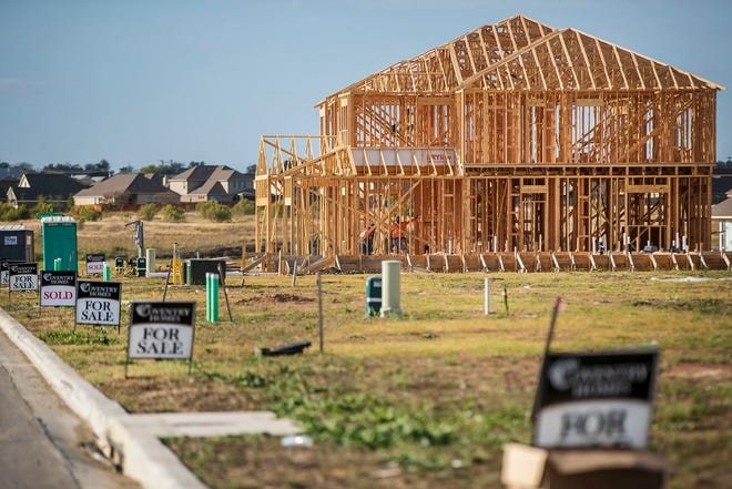 A construction crew works on a new home in a Pflugerville subdivision on  Nov. 20, 2020.  Despite the coronavirus pandemic, 2020 was a record year for the Austin area's housing market.