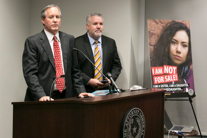 "Texas Attorney General Ken Paxton, left, shown at a 2017 press conference, called sex trafficking ""one of the most heinous crimes facing our society."" [Marjorie Kamys Cotera for The Texas Tribune]"
