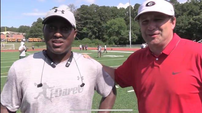Former Georgia defensive back Glenn Ford and Bulldogs coach Kirby Smart at a camp in Atlanta in 2016.