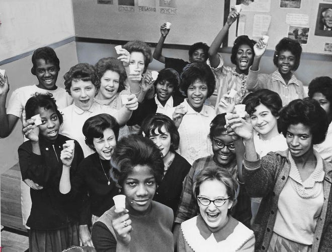 Ninth graders raise a toast to health after taking the Sabin vaccine March 5, 1963, at Thornton Junior High School in Akron.