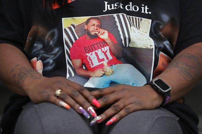 An eighth person has been arrested and face charges in the disappearance and death of Iron Cannon of Akron, who is shown in a snapshot clutched as those close to him kept vigil nearly three months after he went missing Oct. 18.