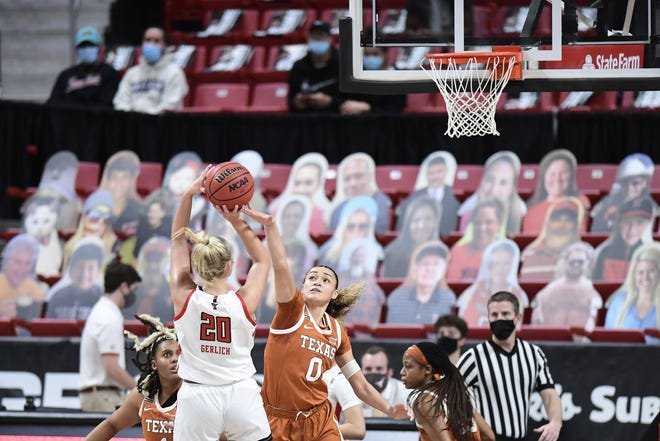 Texas guard Celeste Taylor attempts to defend Texas Tech's Bryn Gerlich during their game in Lubbock on Jan. 17. Texas is 1-2 in games away from Austin this season.