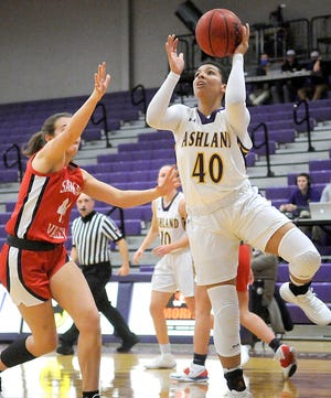 Ashland's Erica Warren (40) puts up a shot against Saginaw Valley State's Tyler Scheid (44) during AU's 73-70 loss Friday at Kates Gymnasium.