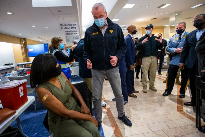 New Jersey Governor Phil Murphy gives the thumbs up gesture to an individual getting vaccinated at the Burlington County mega site. Murphy toured the mega site inside the former Lord & Taylor at Moorestown Mall on Friday morning January 22, 2021.