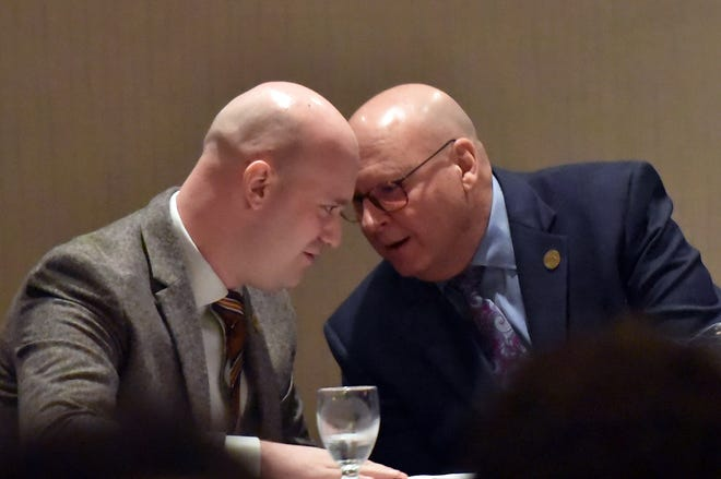 Beaver County Commissioners Dan Camp, left, and Jack Manning, confer during the 2020 State of the County address, sponsored by the Beaver County Chamber of Commerce, last year at the Fez in Hopewell Township.