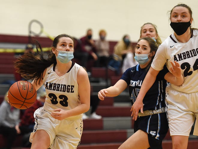 Ambridge's Rachel Guthrie drives to the hoop under pressure from Central Valley's Abbie Borello during Thursday night's game at Ambridge.