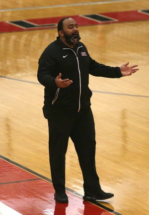 Aliquippa coach Dwight Lindsey gestures during the Quips' game against Shenango Thursday night.