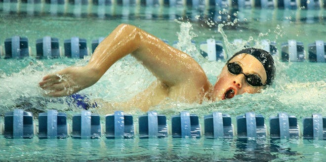 John Steward rips through the water during a competition in an earlier season for Bartlesville High School.