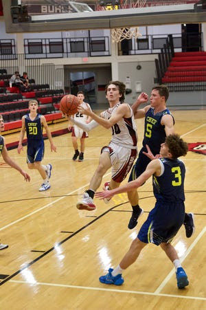 El Dorado's Dravin Fowler (10) cuts through the heart of the Manhattan CHIEF defense in Thursday's second game of the Bluestem Classic.
