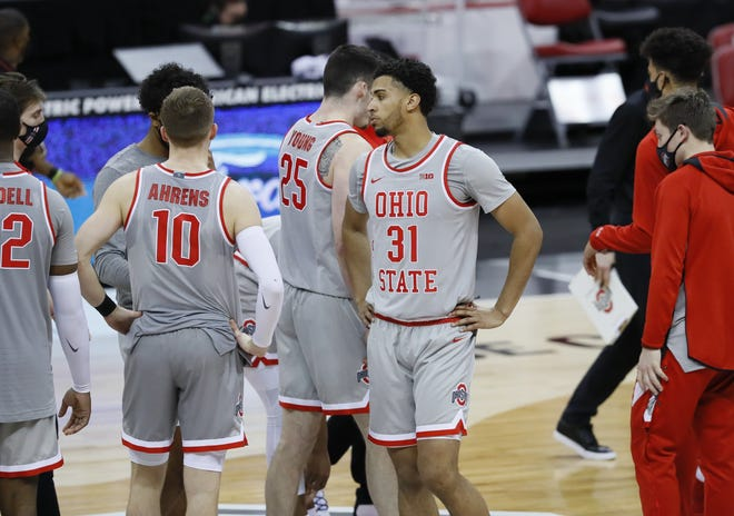 Ohio State Buckeyes forward Seth Towns (31) and teammates leave the court following the men's basketball game against the Purdue Boilermakers at Value City Arena in Columbus on Tuesday, Jan. 19, 2021. Purdue won 67-65.